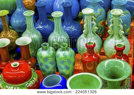 Old Chinese Design Blue Green Red Ceramic Vases  Panjuan Flea Market  Beijing China. Panjuan Flea Curio market has many fakes, replicas and copies of older Chinese products, many ancient.