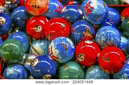 Chinese Replica Metal Buddhist Prayer Balls Decorations Panjuan Flea Market  Decorations Beijing China. Symbols on ball are Ying Yang, famous Buddhist saying on opposites. Panjuan Flea Curio market has many fakes, replicas and copies of older Chinese prod