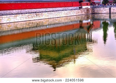 Rear Gate Reflection Heavenly Purity Gugong Forbidden City  Moat Canal Plaace Wall Beijing China. Emperor's Palace Built in the 1600s in the Ming Dynasty