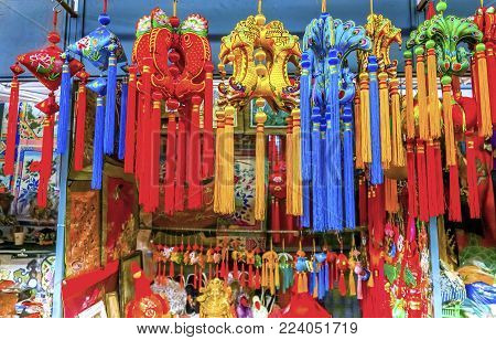 Blue Red Yellow Chinese New Year Silk Decorations Panjuan Flea Market  Decorations Beijing China.  Panjuan Flea Curio market has many fakes, replicas and copies of older Chinese products, many ancient.