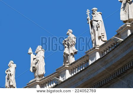 ROME, ITALY - SEPTEMBER 02: Gallery of saints, fragment of colonnade of St. Peters Basilica, Papal Basilica of St. Peter in Vatican, Rome, Italy on September 02, 2016.