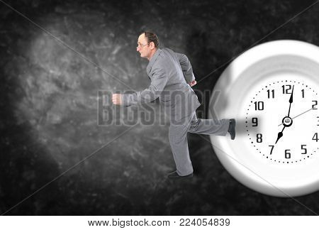 Businessman trying to catch time, collage with running man in black suit and watch on dark plaster background