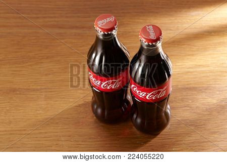 Kuala Lumpur Malaysia 19th December 2016 glass bottle of coca cola on the wooden table
