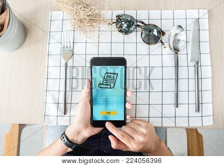 woman pay food via mobile apps at restaurant table.Mobile payment.Digital lifestyle.top view angle