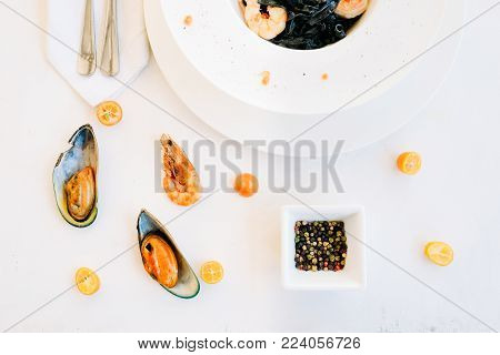 restaurant seafood black pasta recipe concept. traditional kitchen. national cuisine. delicious delicacy.