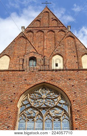 13th century Gothic Collegiate Church of the Holy Cross and St. Bartholomew, facade, Ostrow Tumski, Wroclaw, Poland.  It is a two-storey brick church on the Cathedral Island