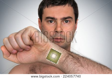 Bionic microchip (processor) inside male human body - future technology and cybernetics concept