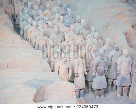 XIAN, CHINA - October 8, 2017: Famous Terracotta Army in Xi'an, China. The mausoleum of Qin Shi Huang, the first Emperor of China contains collection of terracotta sculptures, armored men and horses.