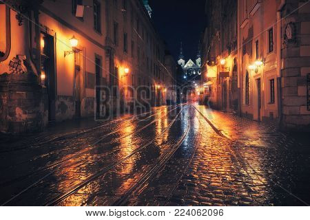 Retro style photo of old European city at night