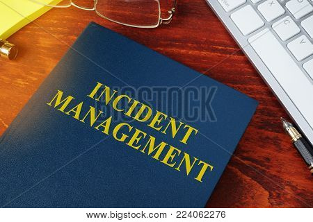 Incident Management concept. Book on the office desk.