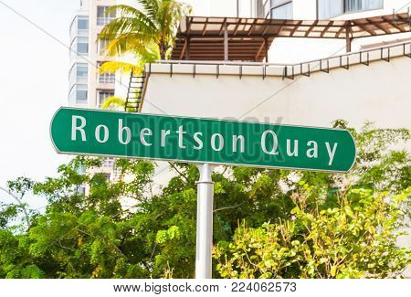 A signpost at Robertson Quay, a tranquil riverside setting in Singapore with residential, hotel and commercial uses.