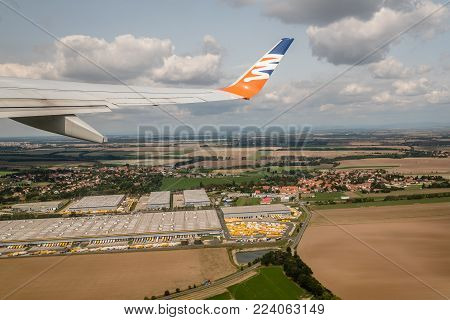 Prague, Czech Republic - August 22, 2017: Airplane wing of Czech airlines short after take off. Amazing view of aircraft wing during flight