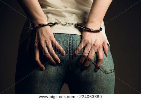 Woman in handcuffs. BDSM concept. Adult role game concept