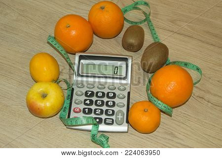 Healthy natural organic food diet, ripe harvest. Fruit composition, measuring tape, calculator. Diet concept, Fruit dieting