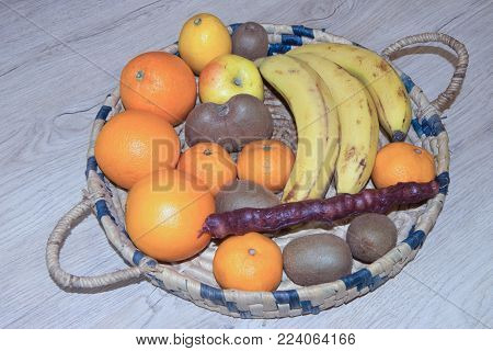 Products with low fat content. Fruits and measuring tape. Diet for weight loss
