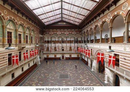 COPENHAGEN, DENMARK - DECEMBER 27, 2016: People in the Great Hall of Copenhagen City Hall. The current building was inaugurated in 1905