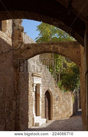 RHODES, GREECE - OCTOBER 9, 2017: Narrow streets inside the citadel of Rhodes. Medieval city of Rhodes is listed as UNESCO World Heritage since 1988