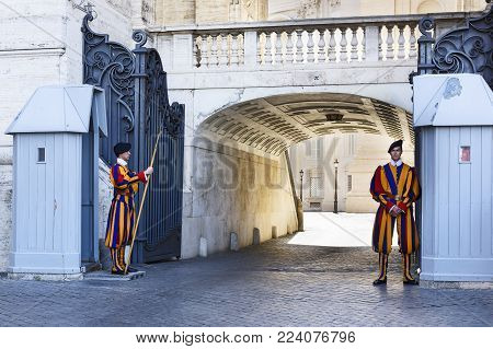 VATICAN CITY, VATICAN - May 25, 2016: Papal Swiss Guard in uniform. Currently, the name Swiss Guard generally refers to the Pontifical Swiss Guard of the Holy See stationed at the Vatican in Rome