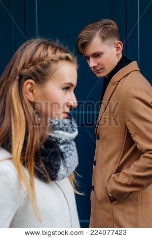 Pickup and flirting concept. Young man interested in a beautiful girl walking by. Modern ways of getting acquainted and meeting people