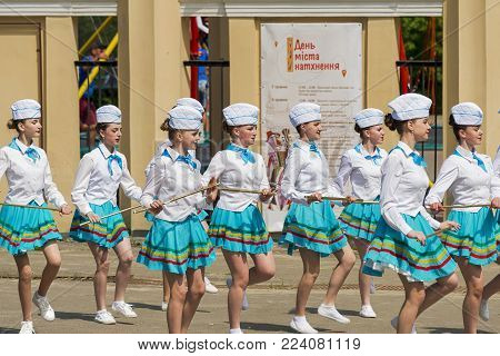 Lviv, Ukraine - May 07. 2017: Band majorettes perform various dancing skills on city park  the annual brass band exhibition in honor of the city day Lviv, Ukraine .