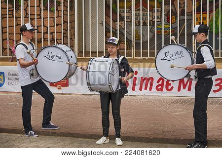 Lviv, Ukraine - May 07, 2017:Unknown drummer play during a rehearsal in the city park before the celebrations of the city's day  of Lviv., Ukraine.