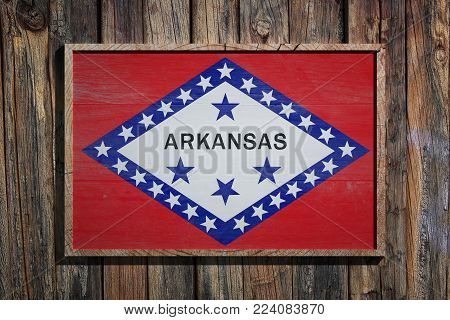 3d Rendering Of An Arkansas State Usa Flag On A Wooden Frame And A Wood Wall