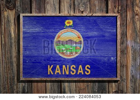 3d Rendering Of A Kansas State Usa Flag On A Wooden Frame And A Wood Wall