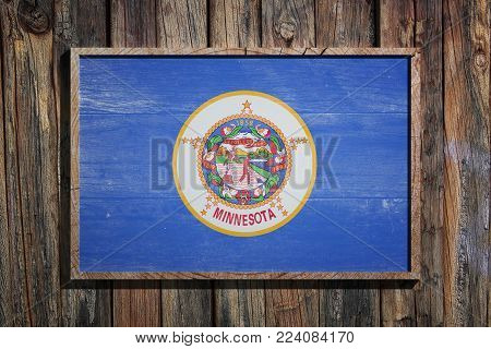 3d Rendering Of A Minnesota State Usa Flag On A Wooden Frame And A Wood Wall