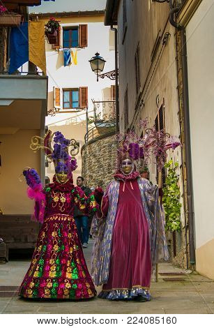 Castiglion Fibocchi, Italy - January 28, 2018: Two Carnival Masks (sons Of Bocco) Walking In The Old