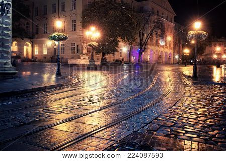 Old European city dark street at night