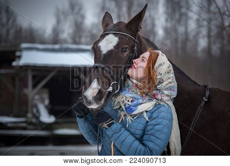 Beautiful young woman with her favorite horse