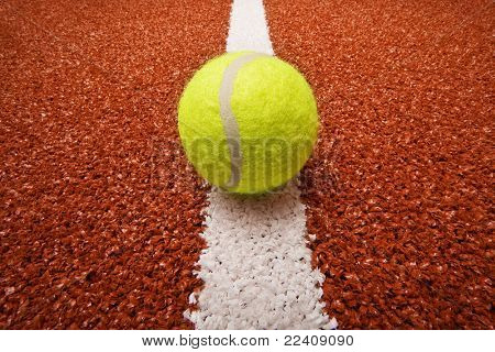 Tennis ball on the court line poster