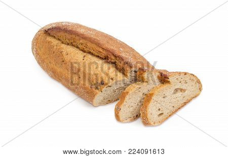 Partly sliced oval loaf of the wheat and rye sprouted bread with added whole sprouted wheat grains, rye malt and molasses, baked in the hearth on a white background