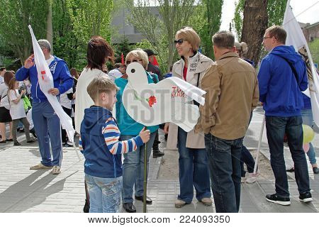 Volgograd, Russia - May 1, 2017: People take part in the May day demonstration in Volgograd
