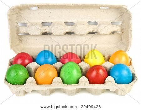 colored easter egg in  eggbox ,isolated on white background