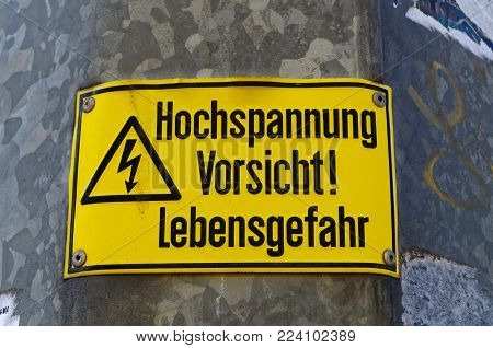 Shield high voltage Caution danger to life in German Hochspannung Vorsicht Lebensgefahr