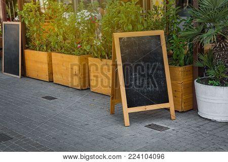 Street chalk board, outdoor stand, summer day