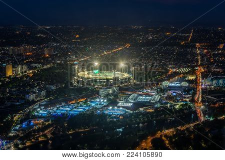 Melbourne, Australia - January 16, 2018: aerial view of Yarra Park, illuminated for the Australian Open and the MCG for a one day cricket international.