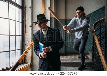 Male bandit with baseball bat attact his victim