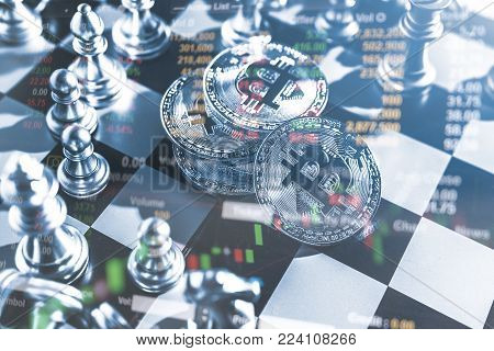 Business idea concept : Bitcoin symbol on chess board game, tock financial statistic graph analysis data concept.