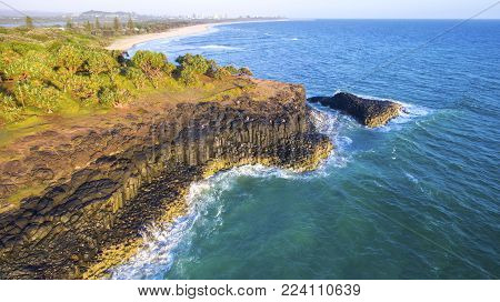 Aerial view facing north over Fingal Head light house and Giants Causeway, NSW Australia.