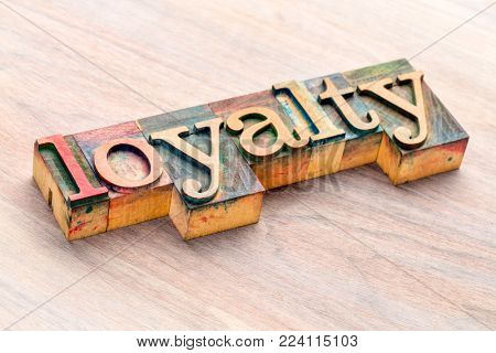 loyalty word abstract in  letterpress wood type printing blocks stained by color inks