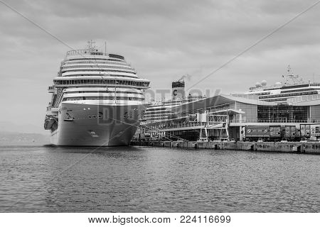 Savona, Italy - December 2, 2016: The Costa Diadema cruise ship in the Ligurian sea port at the cruises terminal in Savona, Italy. Black and white photography.