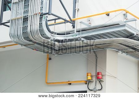good manage network or electric cable with metal flex pipe or outdoor conduit weather proof.