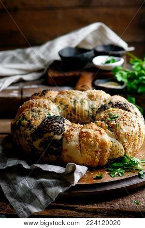 Tear And Share Bread With Herbs And Seeds. Style Rustic.selective Focus