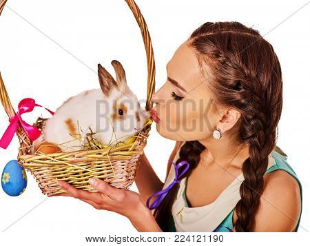 Easter girl holding bunny and eggs. Holiday style holding and group of rabbits in basket with flowers. Spring woman kiss rabbit. White background. Easter discounts on products for women.
