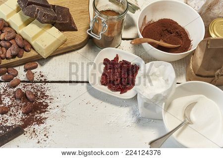 baking ingredients like cacao beans, choclat and sugar