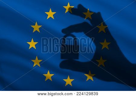 European Union closed lock in the hand. Import and export of goods from the world market of trade is prohibited. Closed borders for tourists and immigrants. Epidemic virus in the country. Top Secret Information
