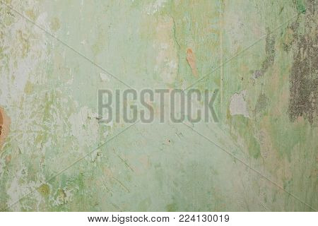 Old gray concrete wall with scuffs and putty green primer, texture background