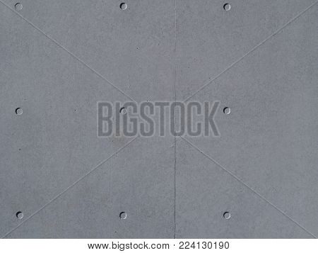 Reinforced concrete wall. Real reinforced concrete wall background. Genuine, weathered, textured reinforced concrete wall.